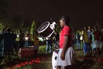 A student at Chumani High School looks through the telescope.